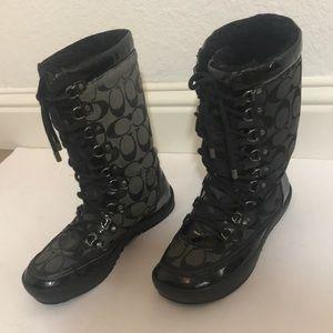 Coach lace up boots.
